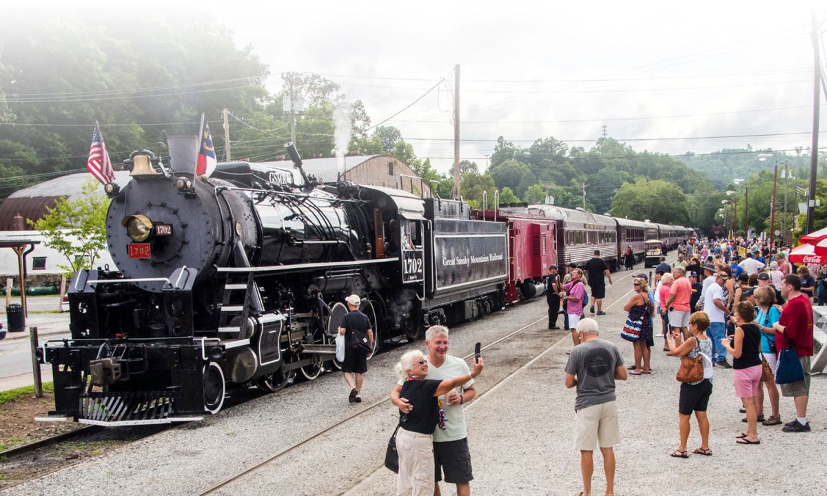 steam train and people ready to board