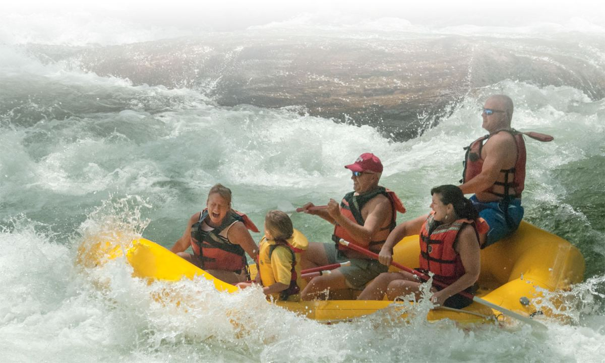 family in yellow raft whitewater rafting