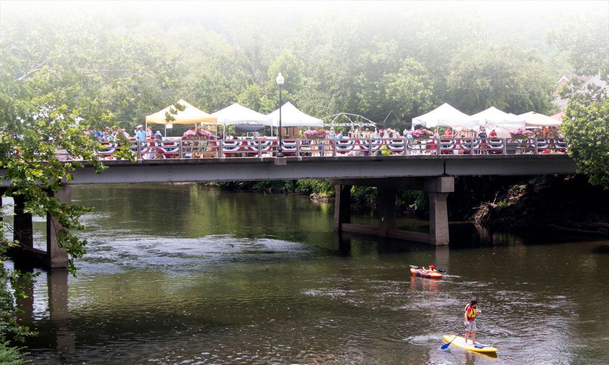 festival on bridge over river