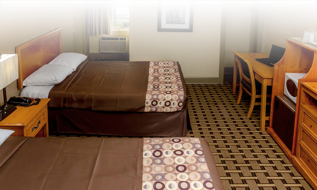 motel room with two beds