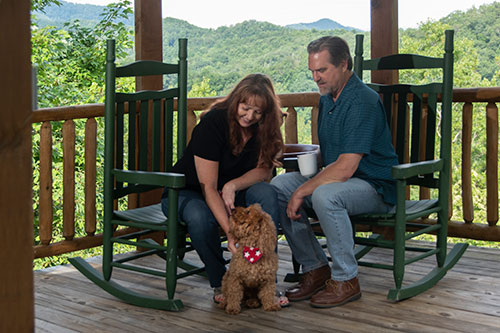 couple with dog on porch
