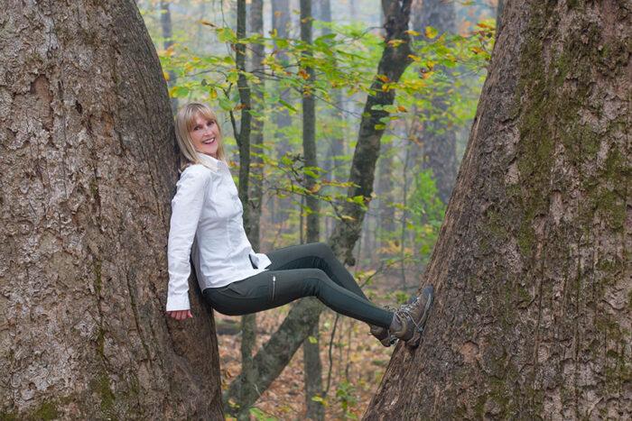 women between two trees